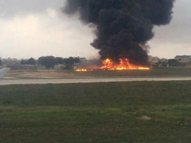 Smoke billows as a light plane crashed after takeoff from Malta airport, in Valletta. AP