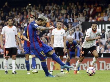 FC Barcelona's Lionel Messi takes a penalty. AP