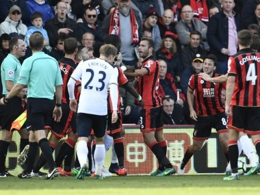 Tottenham's Moussa Sissoko clashes with Bournemouth's Steve Cook and Harry Arter. Reuters