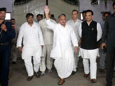 Samajwadi Party chief Mulayam Singh Yadav waves to his party workers as he come out after meeting at his residence in Lucknow on Sunday. PTI