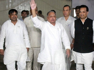 RPT....Lucknow: Samajwadi Party chief Mulayam Singh Yadav waves to his party workers as he come out after meeting at his residence in Lucknow on Sunday. PTI Photo (PTI10_23_2016_000245B)