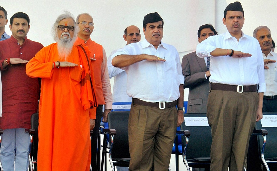 Union Minister Nitin Gadkari along with Maharashtra Chief Minister Devendra Fadnavis dressed in the new RSS uniform at the foundation day ceremony in Nagpur. PTI