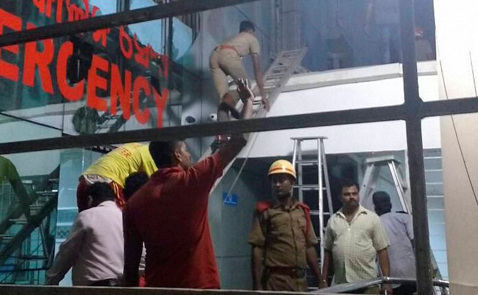 A major fire at the Institute of Medical Sciences and SUM Hospital in Bhubaneswar killed 22 people. Police carried out the rescue work along with the Fire Services Department. Photo: PTI