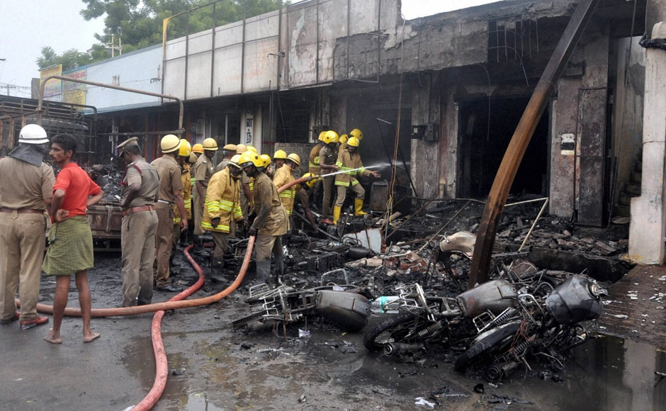 Sivakasi: Fire fighters trying to douse the fire that broke down at a godown containing crackers in Sivakasi in Tamil Nadu on Thursday. PTI Photo (PTI10_20_2016_000246B)