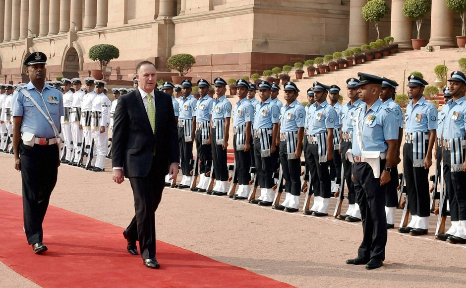 New Zealand's Prime Minister John Key inspects a guard of honor during a ceremonial reception in New Delhi on Wednesday. Modi and Key also agreed to strengthen security and intelligence cooperation against terrorism and radicalisation, including in the domain of cyber security. They also recognised terrorism as one of the greatest challenges to global peace and security. (Photo: PTI)
