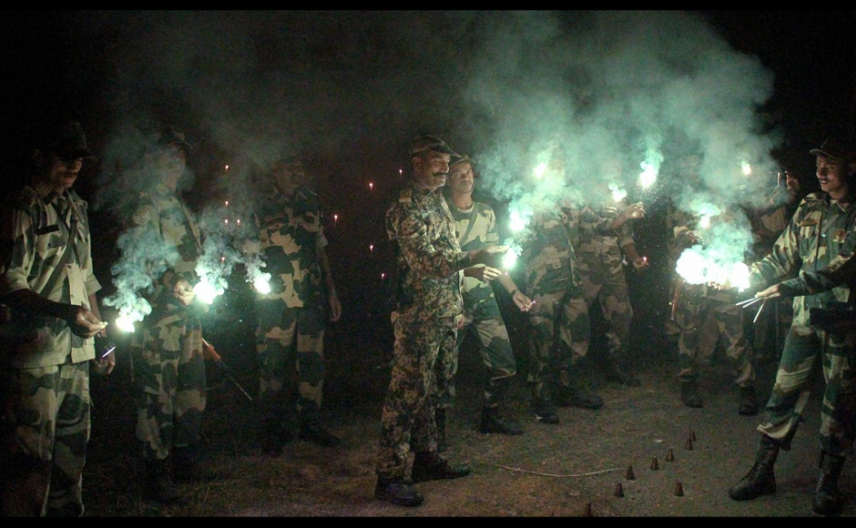 BSF jawans celebrating Diwali near the India-Bangladesh border in South Dinajpur district of West Bengal on Friday. (Photo: PTI)