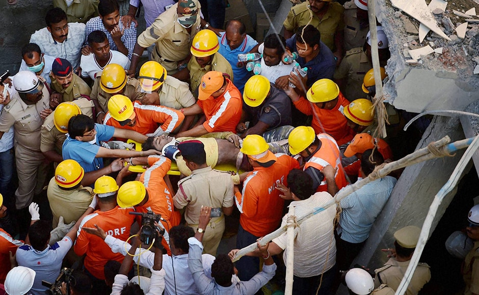 Four persons escaped while one person was rescued alive. NDRF personnel carried the injured person to an ambulance after he was rescued. Photo: PTI