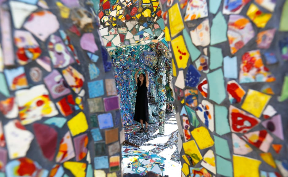 A visitor views the work of artists Gonzalo Duran and Cheri Pann at their Mosaic Tile House in Venice, California, US. Image from Reuters
