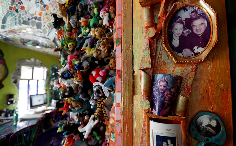 Photos of artists Gonzalo Duran and Cheri Pann are seen in the kitchen of their Mosaic Tile House in Venice, California US. Image from Reuters