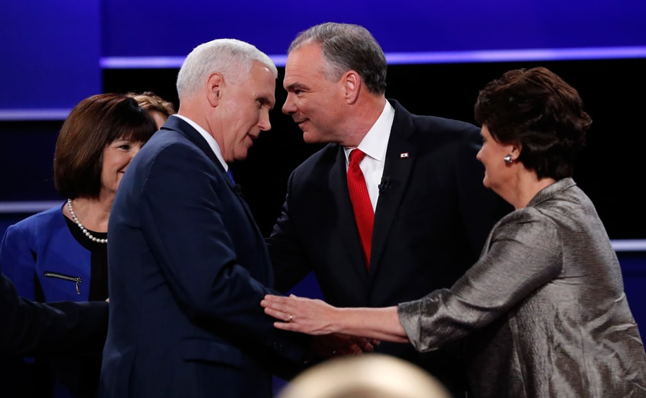 Tim Kaine greets Karen Pence, wife of Mike Pence, as Pence greets Anne Holton, wife of Tim Kaine after the conclusion of their debate. Reuters