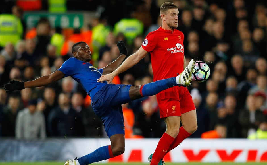 Jordan Henderson in action with Manchester United's Paul Pogba. Reuters