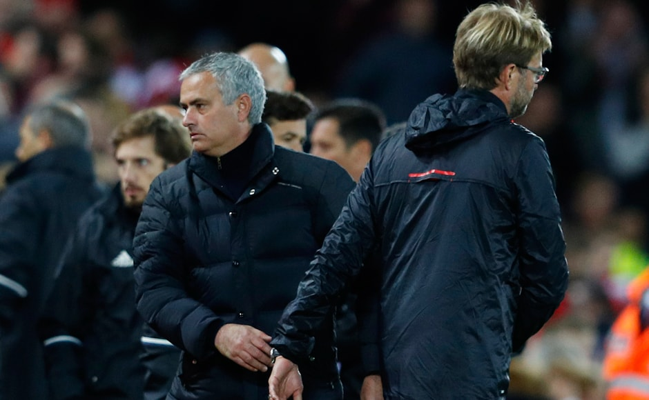 Liverpool manager Jurgen Klopp and Manchester United manager Jose Mourinho greet each other at the end of the match. Reuters