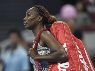 Venus Williams leaves the court after losing to Peng Shuai at China Open. AFP