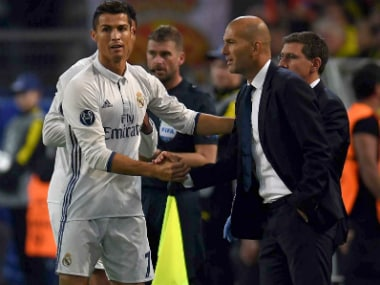 Zinedine Zidane (R) believes Cristiano Ronaldo is the obvious choice for the Ballon d'Or. AFP