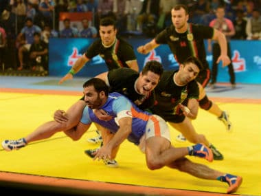 Indian captain Anup Kumar in action against Iran in the Kabaddi World Cup final. AFP