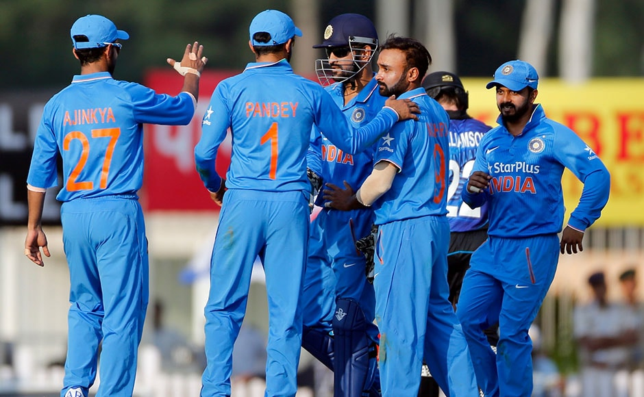 India's Mahendra Singh Dhoni and Amit Mishra celebrates after New Zealand's Kane Williamson's wicket during the forth ODI match. Mishra took 2 wickets at Ranchi. AP