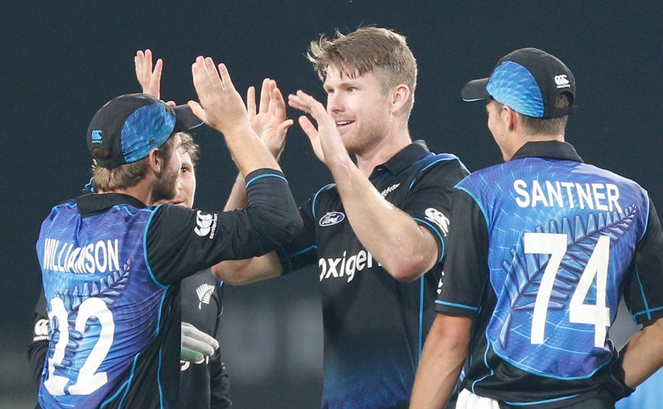 New Zealand's James Neesham celebrates the dismissal of Indian captain Mahendra Singh Dhoni. AP