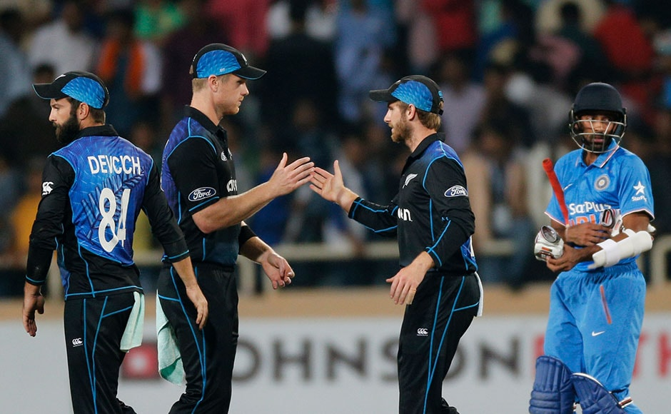 New Zealand's James Neesham and Kane Williamson celebrates after winning the forth ODI match against India in Ranchi. AP