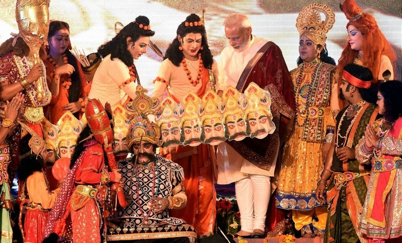 Prime Minister Narendra Modi interacts with the artists during Dussehra celebrations at Aishbagh Ram Leela in Lucknow, Uttar Pradesh on Tuesday. PTI
