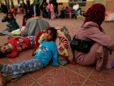 A displaced family sits in the Debaga camp. Reuters
