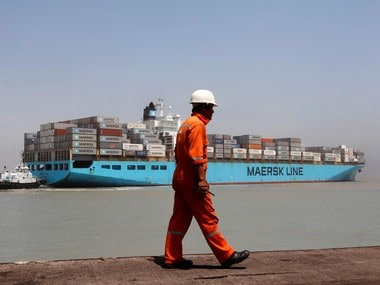 A worker walks past a container ship at Mundra Port in Gujarat. Reuters