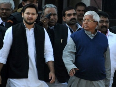 Tejaswi Yadav with his father Lalu Prasad Yadav. Getty Images