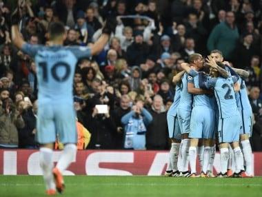 Manchester City players celebrate as  Ilkay Gundogan scores his team's third goal against Barcelona. AFP