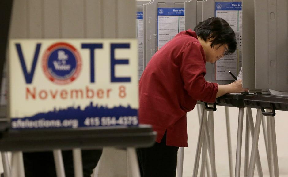 Shu Chu, originally from Taiwan, votes at City Hall in San Francisco. AP