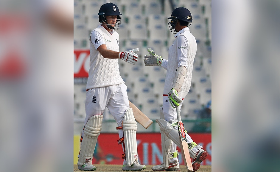 Joe Root is congratulated by teammate Haseeb Hameed after scoring a half-century on the fourth day against India. (AP Photo/Altaf Qadri)