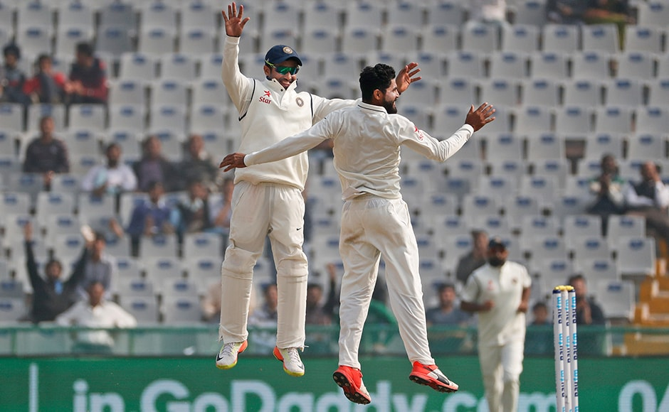 Joe Root (78) scored a gritty half-century, facing 179 balls and scoring six boundaries. Ravindra Jadeja and Karun Nair jump in air as they celebrate his dismissal on the fourth day. (AP Photo/Altaf Qadri)