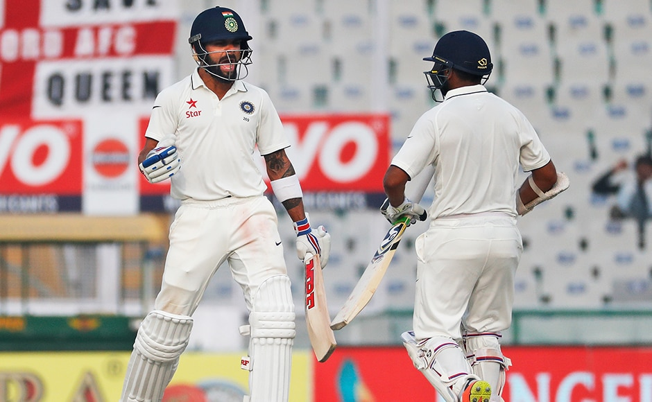 India registered a comprehensive eight-wicket win over England in the third test in Mohali and went up 2-0 in the five-match series. The hosts finished at 104-2 in 20.2 overs, chasing down the 103-run target with resolute ease. (AP Photo/Altaf Qadri)