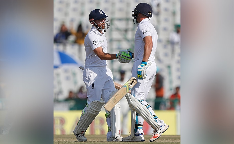 England's Jonathan Bairstow is greeted by his teammate Jos Buttler after he scored half century on the first day. India ended Bairstow's resistance late on Saturday as England reached 268-8 at stumps. AP
