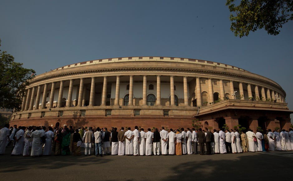 "Opposition parties on Wednesday came together to protest against demonetisation outside Parliament, with Congress vice-president Rahul Gandhi describing it as the world's ""biggest impromptu financial experiment"" and said they are firm on their demand for a JPC probe into the ""scam"". Parties form a human chain outside the parliament building during the protest. (Photo: AP)"