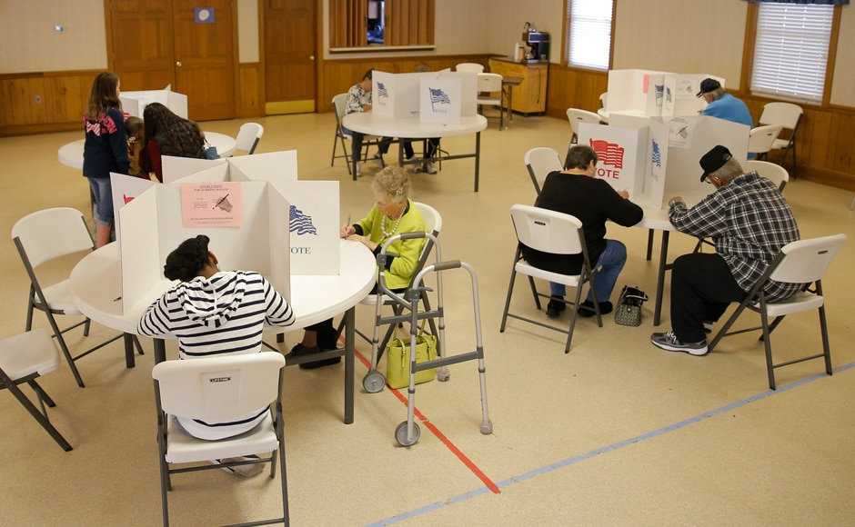 Voters fill out their ballots at a polling station at the Princeton Baptist Church in Princeton, North Carolina. Reuters