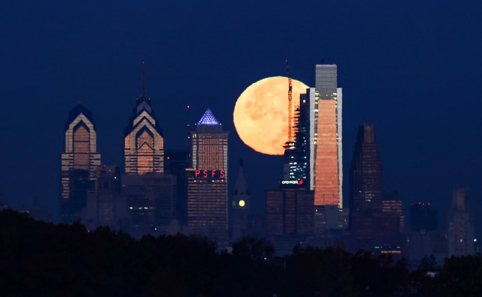 The supermoon sets behind the Philadelphia skyline on Monday. The brightest moon in almost 69 years lights up the sky this week in a treat for star watchers around the globe. The phenomenon is known as the supermoon. AP