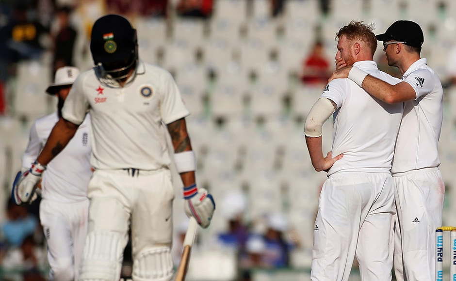 England's Ben Stokes and James Anderson celebrate the dismissal of India's Virat Kohli. Kohli was out for 62 on Day 2 in Mohali. Reuters