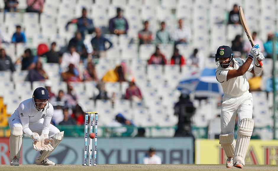 Cheteshwar Pujara and Kohli had added 75 runs for the third wicket on Day 2. Pujara had reached his 11th test half century off 100 balls, inclusive of eight fours. (AP Photo/Altaf Qadri)