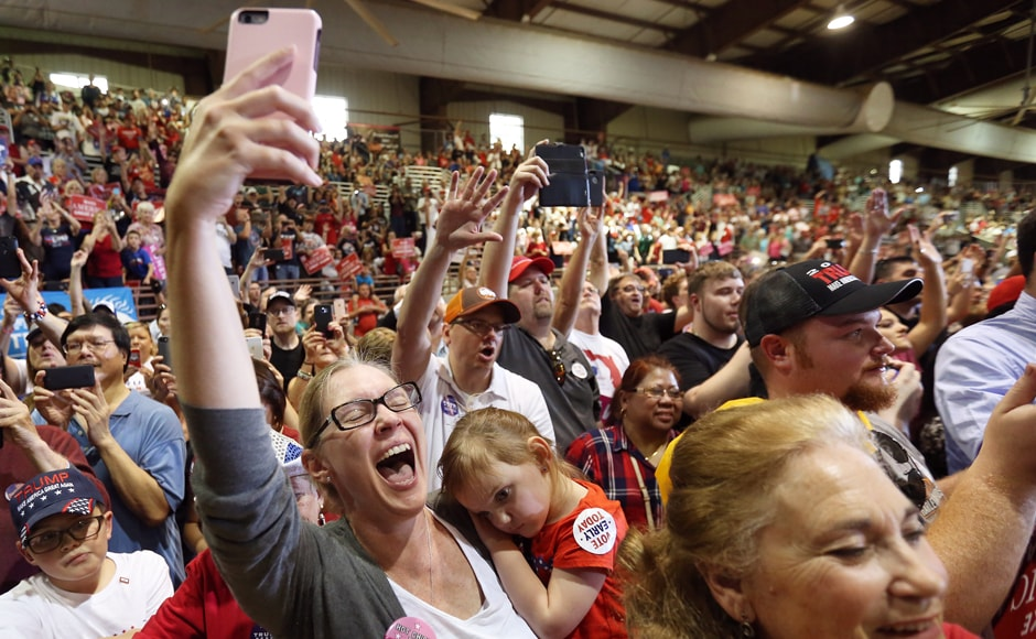 People cheer as Republican presidential nominee Donald Trump speaks at a campaign event at the Jacksonville Equestrian Center in Jacksonville, Florida U.S. November 3, 2016. REUTERS/Carlo Allegri