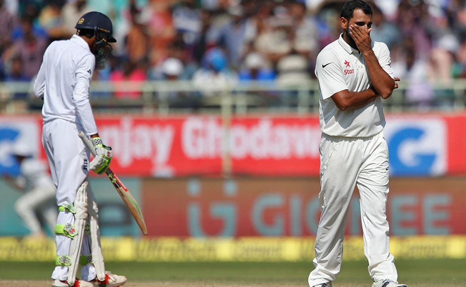India's Mohammed Shami, right, reacts after England's Haseeb Hameed, left, hit a boundary on his delivery on the fourth day of their second cricket test match in Visakhapatnam, India, Sunday, Nov. 20, 2016. (AP Photo/Aijaz Rahi)