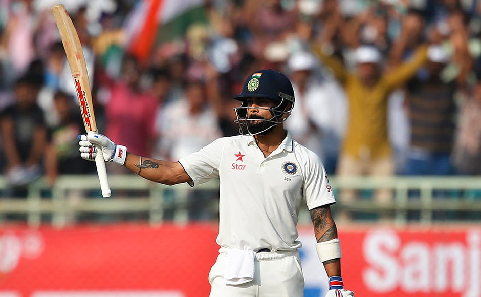 India's captain Virat Kohli raises his bat to celebrate scoring a century on the first day of their second cricket test match against England in Visakhapatnam, India, Thursday, Nov. 17, 2016. (AP Photo/Aijaz Rahi)
