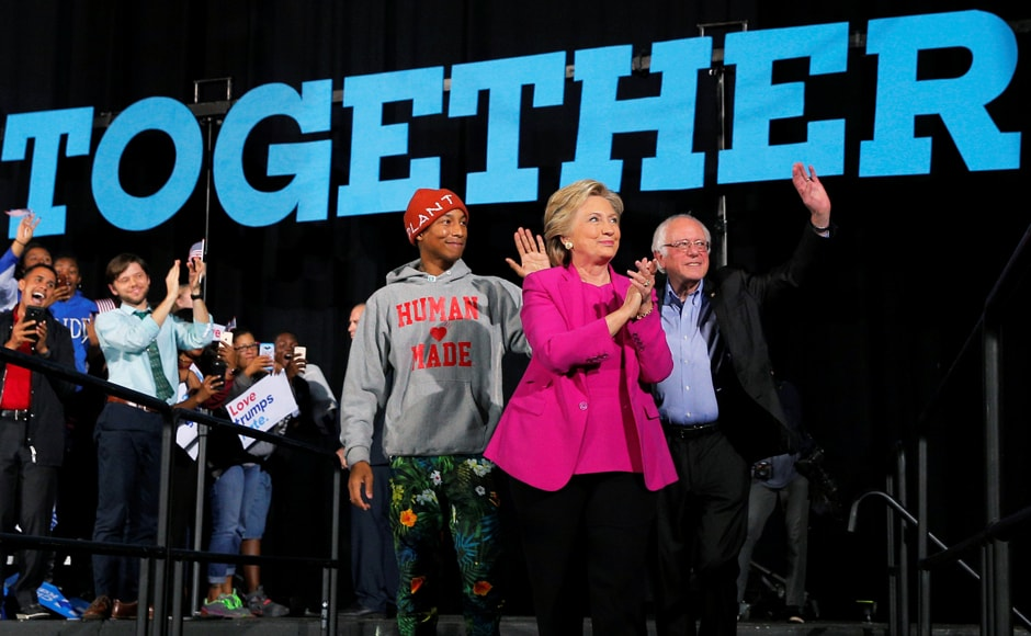 U.S. Democratic presidential nominee Hillary Clinton takes the stage with musician Pharrell Williams (L) and U.S. Senator Bernie Sanders (R) at a campaign rally in Raleigh, North Carolina, U.S. November 3, 2016. REUTERS/Brian Snyder TPX IMAGES OF THE DAY