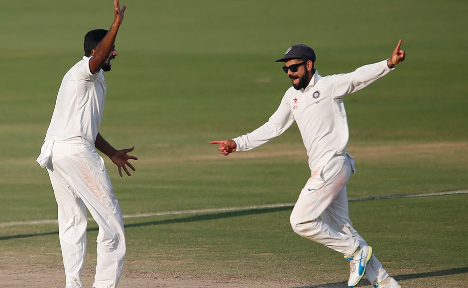 India's captain Virat Kohli, right, and Ravichandran Ashwin celebrate the dismissal of England's Haseeb Hameed on the fourth day of their second cricket test match in Visakhapatnam, India, Sunday, Nov. 20, 2016. (AP Photo/Aijaz Rahi)