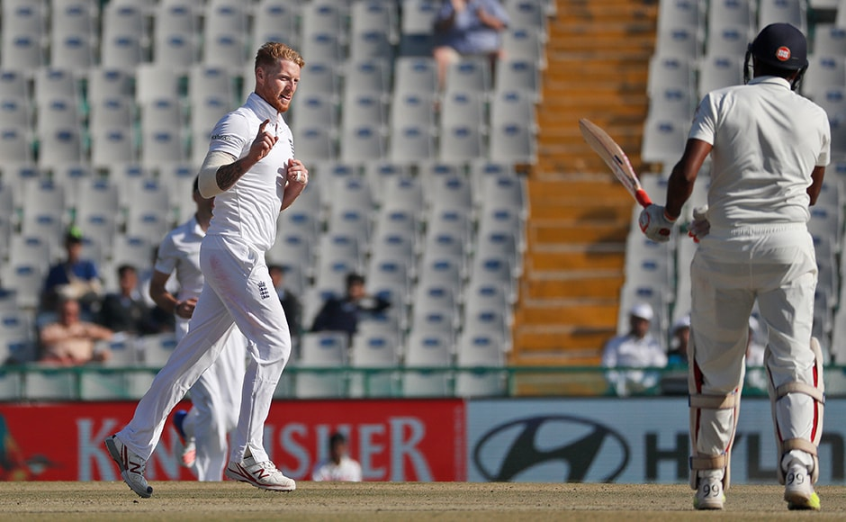 England's Ben Stokes, left, celebrates after taking the wicket of India's Ravichandran Ashwin on the third day in Mohali. (AP Photo/Altaf Qadri)