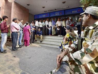 People queue up to change their old currency notes outside Bank of India in New Delhi. PTI