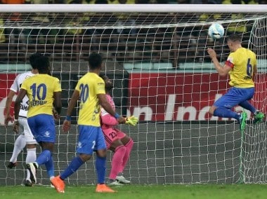 Aaron Hughes of Kerala Blasters FC takes a shot to score against FC Pune City. ISL