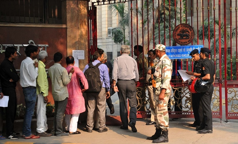 Crowds gather outside the RBI on Thursday. Naresh Sharma/ Firstpost