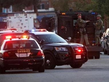 Police officers are seen at the scene of a shooting near a polling station, in Azusa, California. Reuters