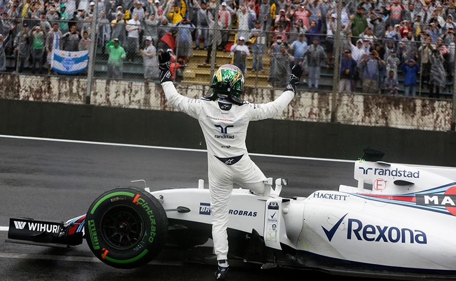 The Brazilian public welcomed their hometown hero with open arms in his last ever Brazilian GP. AP