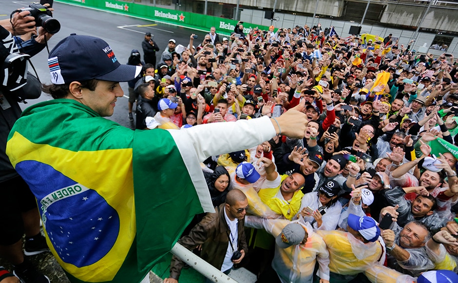 Felipe Massa gestures to fans who invaded the Interlagos race track to celebrate his career. AP