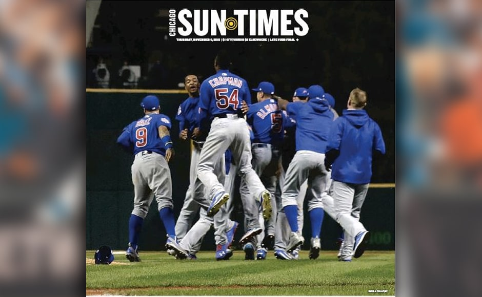 "Chicago Sun-Times went without a headline on the front cover, with the wraparound on the back reading, ""What a wonderful world."""